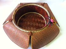 Made out of bamboo and rattan, this lovely basket if perfect fot decoration.
